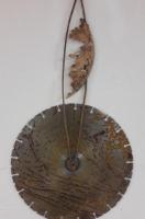 ijzeren slijpschijf met bronzen veer