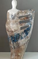 figuurtje van keramiek met soort vleugel